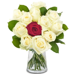 Bouquet of white roses with one red rose