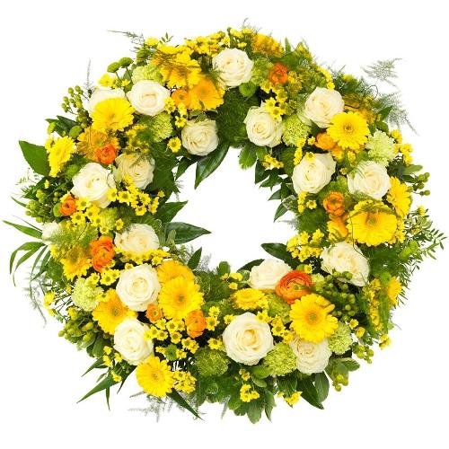 Gele rouwkrans met groen