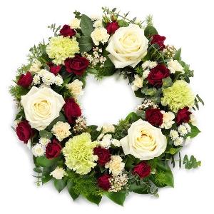 Witte rouwkrans met rood