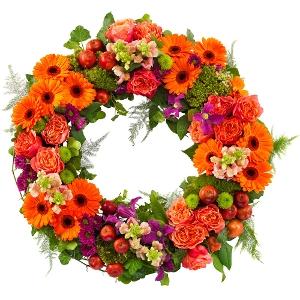 Oranje rouwkrans met paars