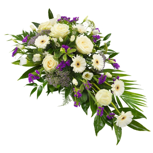 Wit rouwarrangement met lila